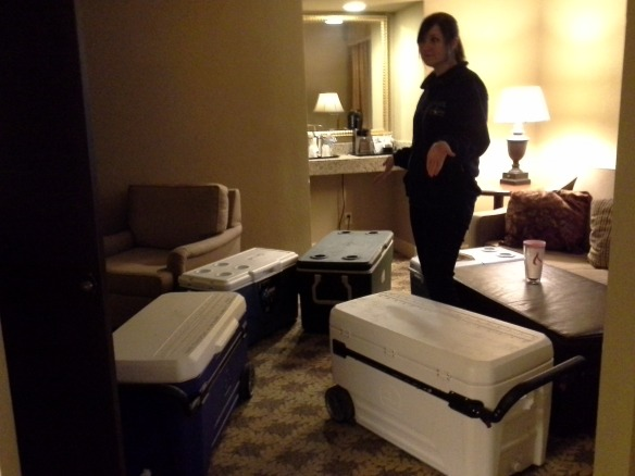 Alle Foster at a Chattanooga hotel with the alligator coolers.