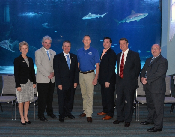 (L-R) Kentucky state Sen. Katie Stine; City of Newport Commisioner John Hayden; Kentucky state Rep. Dennis Keene; Newport Aquarium VP & Executive Director Eric Rose; City of Newport Vice Mayor Tom Guidugli; Campbell County Judge Executive Steve Pendery; Kentucky Travel & Tourism Executive Director Todd Cassidy
