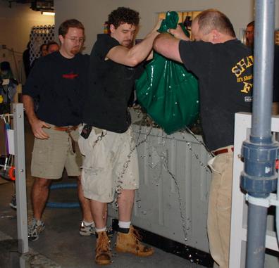 Area Supervisor Dan Hagley (center left) oversees multiple exhibits at Newport Aquarium.