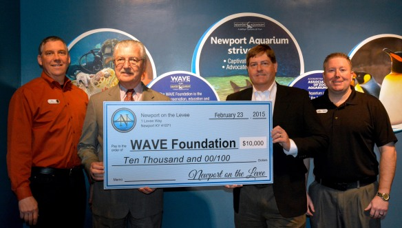L-R: Newport Aquarium Executive Director Eric Rose, Newport on the Levee General Manager Harold Dull, WAVE Foundation Board of Directors Chairman Mark Evans, WAVE Foundation Education Program Manager Dan Dunlap