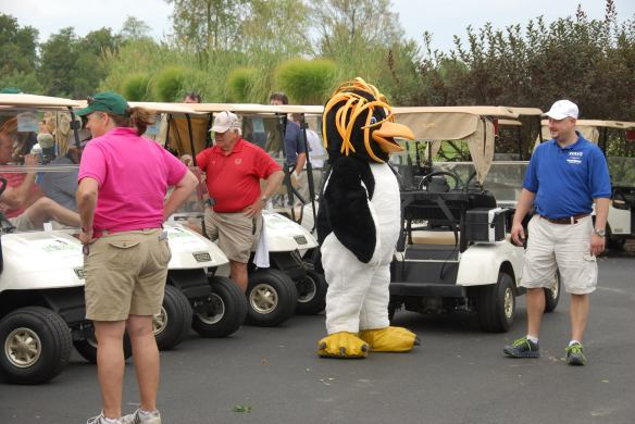 Rocky the mascot with golfers
